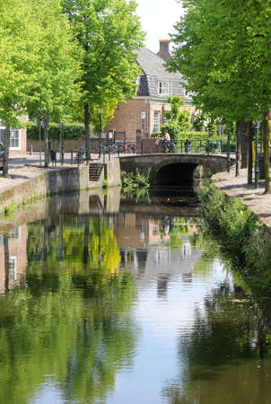 Amersfoort, Netherlands, may 2014 Canal with bridge, houses and reflections at The Havik in the old town of Amersfoort