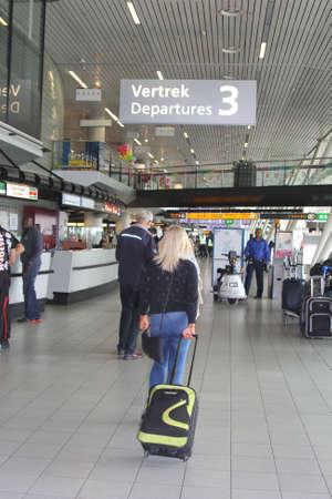 schiphol: Schiphol, Amsterdam, Netherlands, may 2014 Departing passengers at Schiphol International Airport