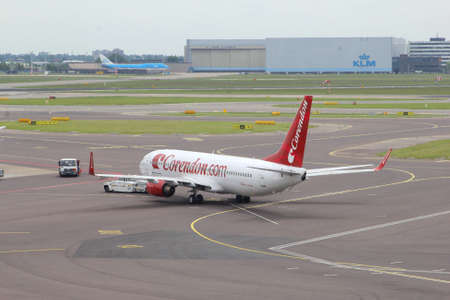 Schiphol airport, Amsterdam, Netherlands, may 2014 A Boeing 737-800 of Corendon is departing