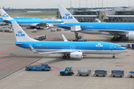 Schiphol Airport, Amsterdam, Netherlands Planes of the Royal Dutch Airlines KLM at the gates Editorial