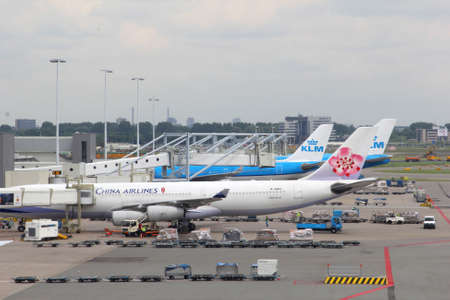 Schiphol airport, Netherlands, may 2014 Airplane of China Airlines at the gate