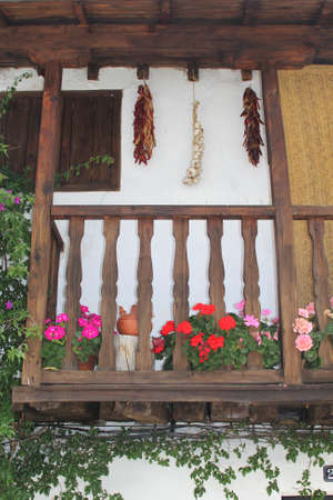 характеристика: Characteristic wooden balcony with flowerpots, Spain