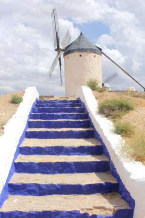 Traditional Spanish ancient windmill in Castilla La Mancha, Spain photo