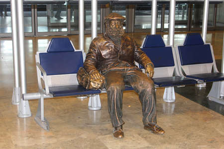 barajas: Barajas airport,Madrid,Spain, june 2014 Street artist statue of a traveller at Barajas International Airport