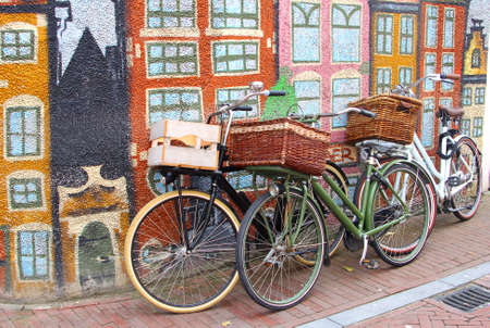leeuwarden: Bikes against a colorful graffiti wall with painted canal houses in Leeuwarden, Holland