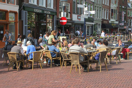 gastronome: Leeuwarden, Friesland, Netherlands, may 2014 People at a cosy terrace in the city centre of Leeuwarden Editorial