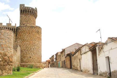Street with medieval castle and old houses in Oropesa, Castle La Mancha, Spain