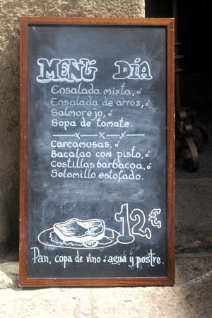 andalusian cuisine: Spain, 2014 Blackboard with a Spanish daily menu, written with chalk
