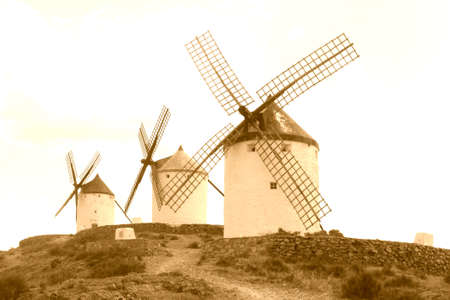 Traditional ancient windmills along the Don Quichot route, La Mancha, Spain photo