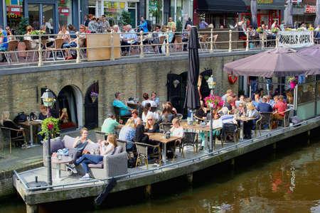 leeuwarden: Leeuwarden,Friesland, Netherlands, 2014 People enjoy at terraces along a canal in the city centre of Leeuwarden