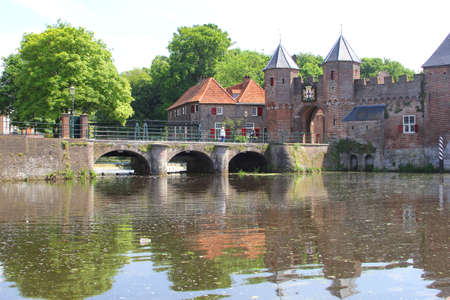 eem: Amersfoort, Netherlands, may 2014 Eem river, bridge and ancient gate the Koppelpoort  Editorial