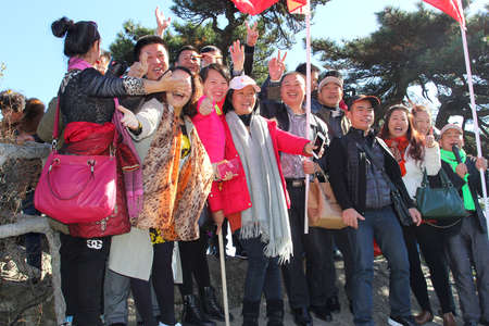 Huangshan, China, november 2014 Chinese tourists with are hiking in the Yellow Mountains (Unesco)