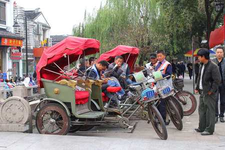 Suzhou, province Jiangsu, China, november 2014 Rickshaws for transport in the city centre of the ancient water town Suzhou Editorial