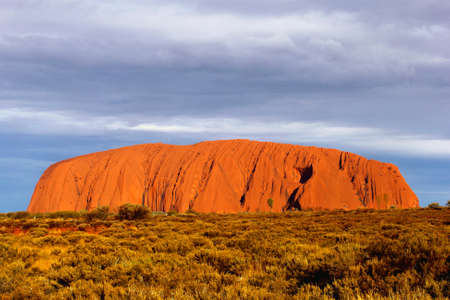 Uluru Kata Tjuta National Park, Australia Orange colors of Ayers Rock (Unesco) during sunset, the biggest mountain in the world Editorial