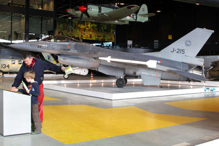 soest: Soesterberg, Netherlands, 2015  Father and son near a fighter in the National Military Museum Editorial