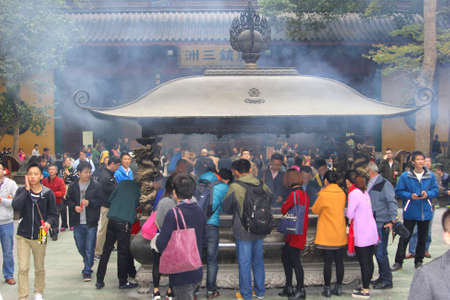 Hangzhou, China,november 2014 People are burning incense, a religious ritual in the Confucian Lingyin temple