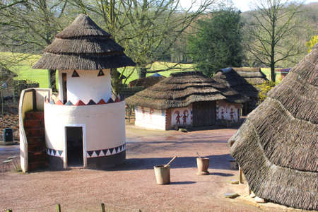 afrika: Groesbeek  Nijmegen, Netherlands, 2015 Primitive African huts with decorations in the Afrika Museum in Berg en Dal
