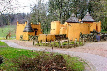 afrika: Groesbeek  Nijmegen, Netherlands, 2015 Primitive yellow African village huts in the Afrika Museum in Berg en Dal