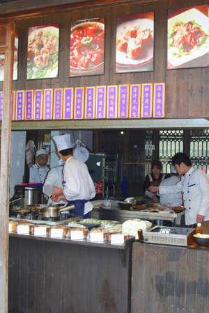moneymaking: Wuzhen China in November 2014 Cooks are preparing meals in a takeaway restaurant in Wuzhen