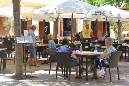 culinary tourism: Alcudia Mallorca Spain May 2015 People relax and enjoy at an outdoor terrace