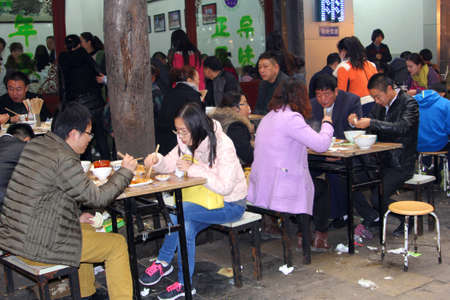 gastronome: People are eating in a restaurant in Xian, China