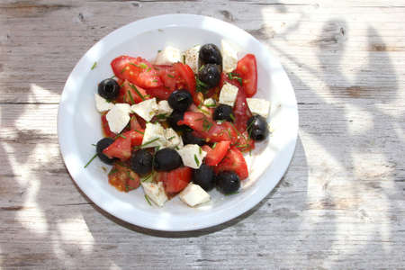 gastronome: Mediterranean salad on a rustic wooden background