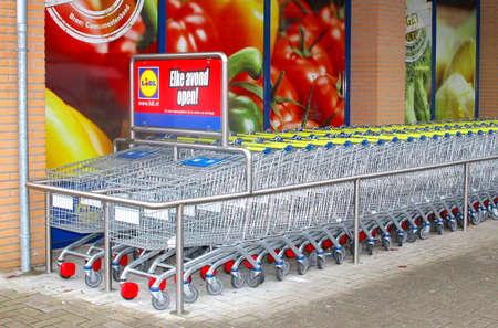 soest: Supermarket carts of the Lidl discount supermarket store, Netherlands Editorial