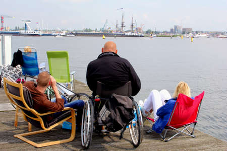 Amsterdam, Netherlands, August 19, 2015 People are watching the tall ships on the IJ river falling on the Sail 2015 event