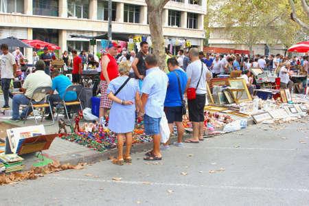 fleamarket: Valencia, Spain, August 31, 2014, People enjoy the outdoor sunday flea market in the city center of Valencia Editorial