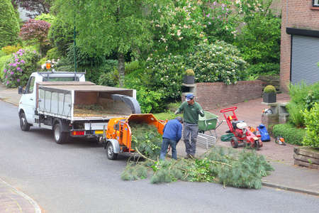 soest: Soest, Netherlands, May 2014, Gardeners at work with the wood shredder
