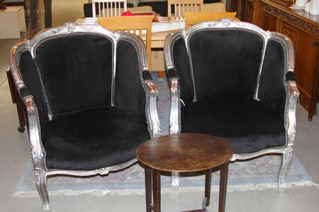 arm chairs: Pair of retro vintage arm chairs in a thrift store, flea market