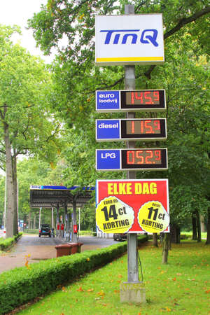low prices: Soest, Netherlands, September 2015, Tinq petrol station in the forest with low prices for diesel, LPG and unleaded petrol