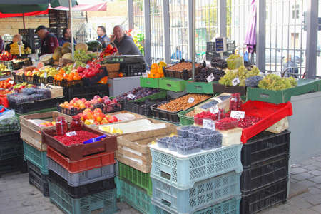 specifies: Vilnius, Lithuania, October 2015 Stand of fruits and berries in an indoor marketplace