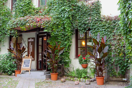 gastronome: Vilnius, Lithuania, October 2015, Idyllic courtyard of a cafe restaurant in the Old town of Vilnius