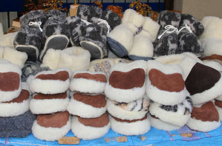 specifies: Handicrafted woolen carpet slippers are sold in Vilnius and Tallinn Stock Photo