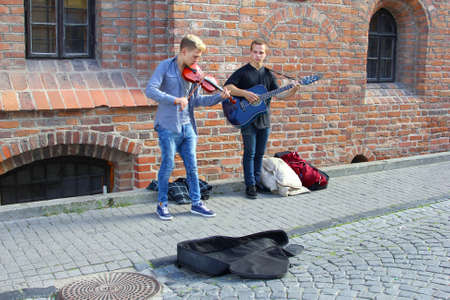 making music: Vilnius, Lithuania, October 2015, Young musicians are making music in the Pilies street in the city center of Vilnius