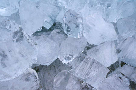 drifting ice: Natural ice cubes into drifting ice in closeup