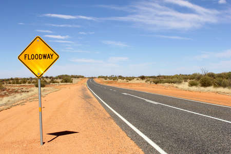 the outback: Floodway warning sign in the Australian Outback
