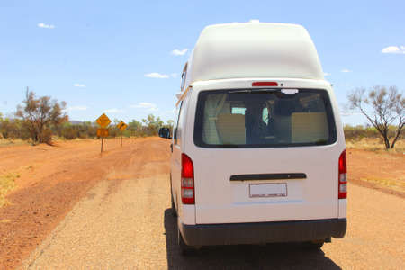 4wd: Recreational vehicle drives at an unsealed 4WD road in the Red Centre, Australia