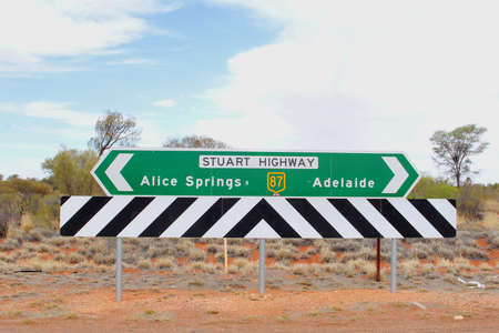 signboards: Signboards to Adelaide and Alice Springs at the Stuart Highway, Australia