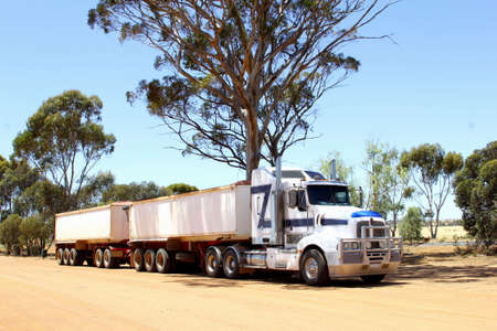 australasia: Cargo trailer, road train transports freight at the Stuart Highway in Australia Stock Photo