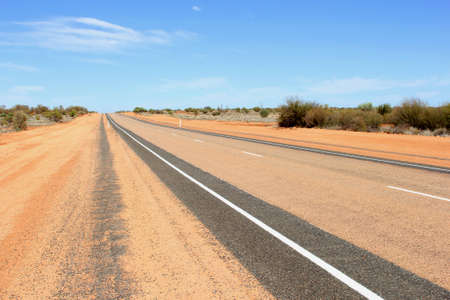 ayers: Lasseter Highway connects Yulara and Uluru Ayers Rock with the Stuart Highway through the desert