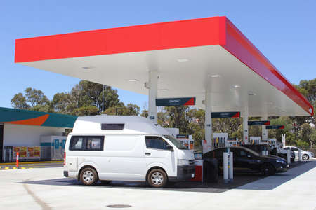 busselton: Buselton, Western Australia, in December 2015 Recreational vehicle and other vehicles refuel petrol and diesel at a gas station Vortex Editorial
