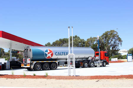 petrol station: Busselton, Western Australia, in December 2015 Caltex cargo trailer delivers oil, gas and petrol at a petrol station