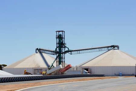 unloading: Cargo trailers are unloading grain at the grain silos