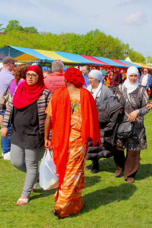 woman s bag: Soest, Netherlands, April 27, 2014 Muslim woman and integration at Kingsday