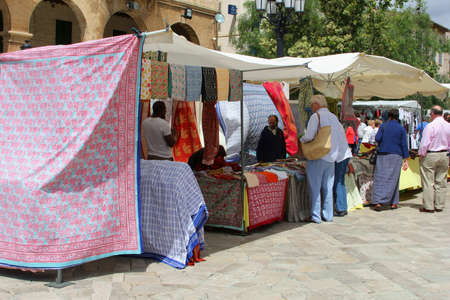 weekly market: Inca, Mallorca, Spain, May 2015 People are shopping at the textiles stand at the weekly market Editorial