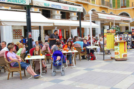 have fun: Palma de Mallorca, Majorca, Spain, May 2015 People drink wine an have fun at a cafe terrace at the Plaza Mayor