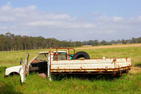 abandoned car: Abandoned rusty pickup car wreck in the fields, Australia