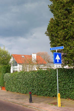 wilhelmina: Signboard for a one-way street and a street name board of the Wilhelminalaan, Netherlands